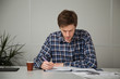 entrepreneur in casual clothes sitting at a table, studying documents