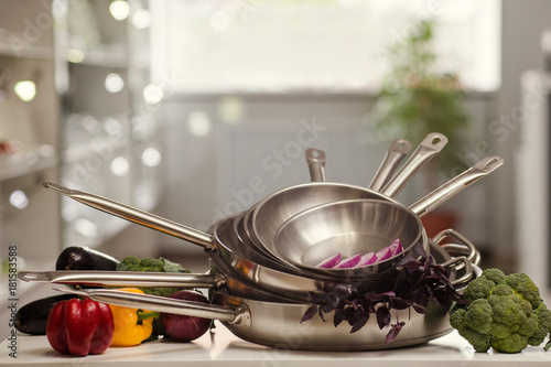 stack of cooking and frying pans with free space above. Kitchen utensils shop advertisement concept