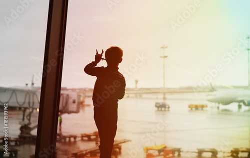 Fototapety, obrazy: boy playing with toy plane while waiting in airport