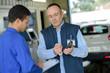 mechanic guiding the apprentice on making estimates