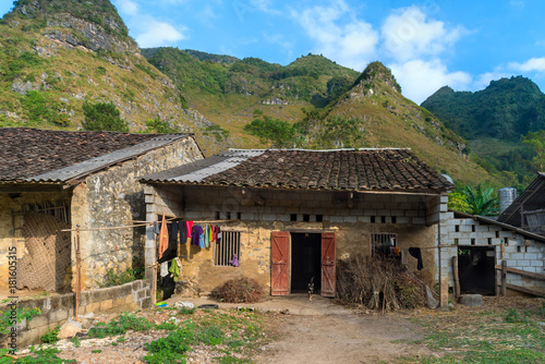 Fotografie, Obraz  Hill tribe houses in Vietnam with beautiful mountains and skies.