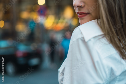 Romantic young woman at street