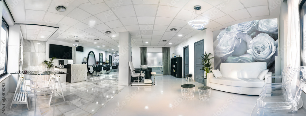 Fototapeta Panoramic view of a modern bright beauty salon. Hair salon and pedicure interior business