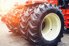 Modern Red Tractor With Big Wheels