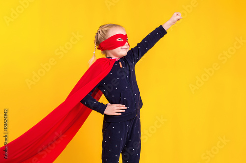 Superhero little girl in a red raincoat and a mask Wallpaper Mural