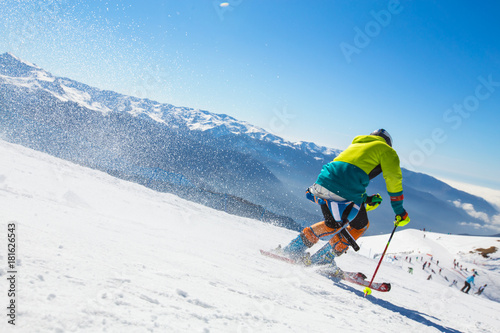 Wallpaper Mural man skiing  in the mountains