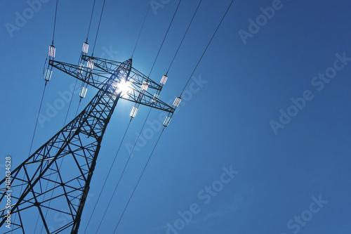 Fototapeta electricity pylon with sun and sky