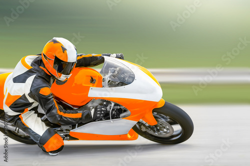 Papiers peints Motorise Motorcycle practice leaning into a fast corner on track