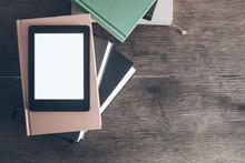 E-reader On Stack Of Books On ...