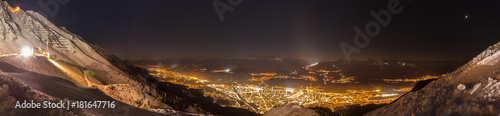 Fotografie, Tablou  Panorama over Innsbruck, the Capital of the Alps, under the stars