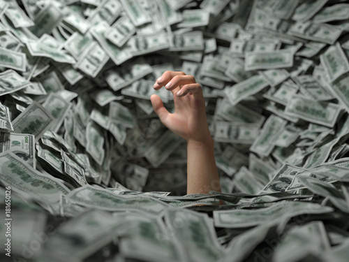 Fototapeta hand drowning in money