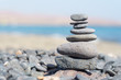 Close-up of stack of stones in perfect balance on a tranquil sunny beach in Fuerteventura, SpainClose-up of stack of stones in perfect balance on a tranquil sunny beach in Fuerteventura, Spain