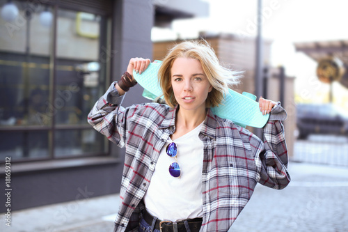 Canvas Prints Textures Attractive hipster girl with skateboard on street