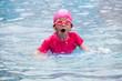 cute kids playing water sport games in pool