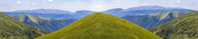 Panorama Of Green Hills In Sum...