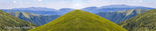 Fototapeta Panorama of green hills in summer mountains obraz