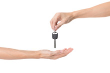 Hand Holding Car Key And Handing It Over To Another Person Isolated On White Background