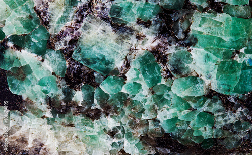 Malachite in mica group of sheet silicate minerals. Natural decorative stone texture pattern macro view.