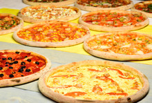 Pizza Circles With Meat, Mushrooms, Tomatoes And Cheese