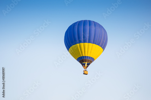 Foto op Canvas Luchtsport Colorful of hot air balloon with fire and blue sky background