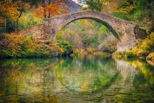 Ancient Roman Stone Bridge Pont Des Tuves Across The Siagne River Surrounded By Yellow Autumn Trees Near Saint-Cezaire-sur-Siagne, Alpes Maritimes, France