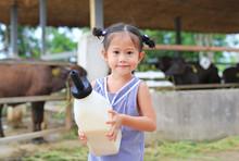 Little Farmer Girl Holding Mil...