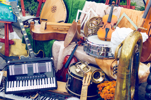Pile of different old musical instruments - 181704132
