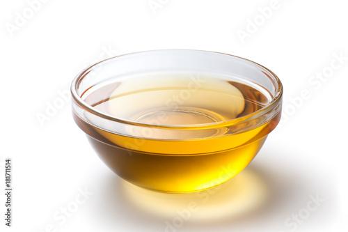 Fototapeta Fresh peanut oil in a glass bowl on white background obraz