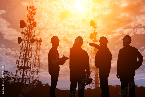 Slika na platnu Silhouette Teams engineer looking Telecommunication mast television antennas on