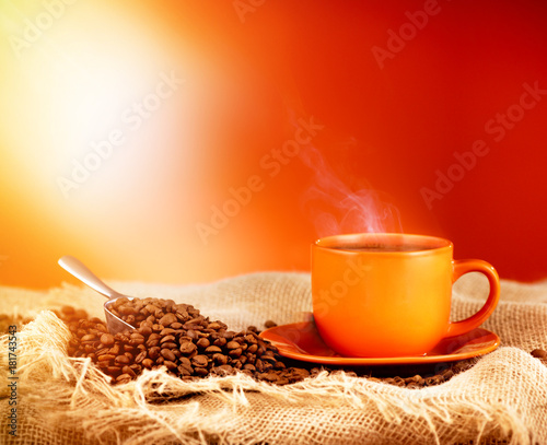 Wall Murals Coffee beans Cup hot coffee and sunlight with copy space for text