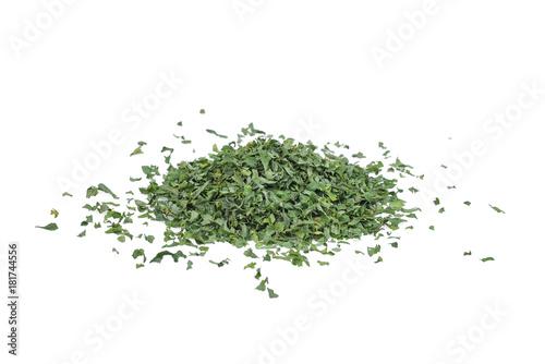 pile of dried parsley leaf or petroselinum crispum isolated on white