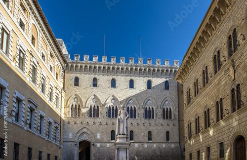 Fotografie, Obraz  front view of Sallustio Bandini Statue in Piazza Salimbeni, Siena, Italy