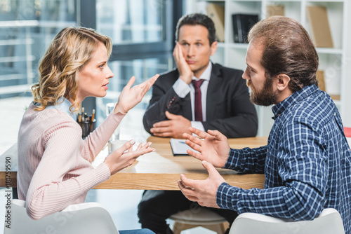 couple arguing at lawyer office Canvas Print