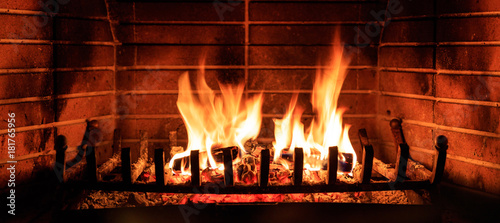 Photo Logs burning in a fireplace