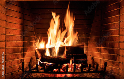 Fotografiet  Logs burning in a fireplace