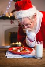 Santa Claus Selecting Cookies ...