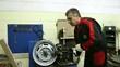 Mechanic repairing car tire