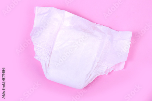 Fotografiet diapers for children on a pink background