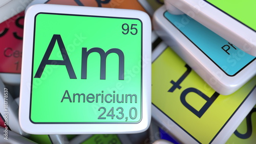 Photo Americium Am block on the pile of periodic table of the chemical elements blocks