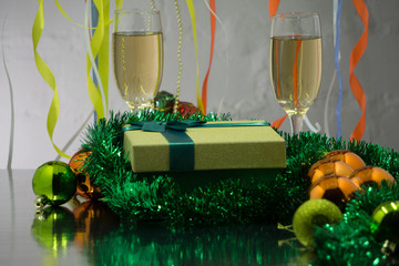 Two glasses of champagne on the background of Christmas decorations