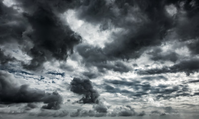 Fototapeta Niebo Dramatic thunderstorm clouds background at dark sky