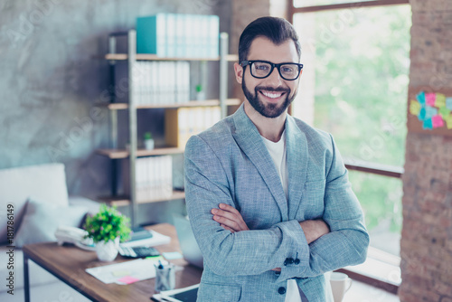 Fotografia  Portrait of young, happy economist with beaming smile and stubble after work, st