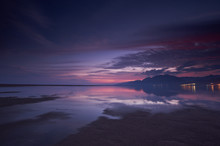 Sunset Over A Beach During Low...