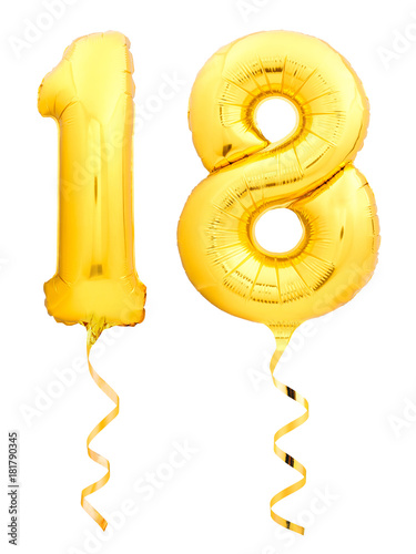 Photo Golden number 18 eighteen made of inflatable balloon with ribbon isolated on whi