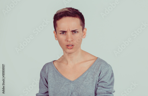 Fotografia, Obraz  Head shot angry bitchy woman skeptically looking at you isolated on light green grey wall background