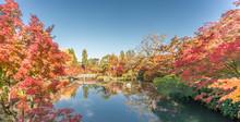 Beautiful Autumn Colors, Fall Foliage And Gorukaku Stone Bridge Across The Hojo-ike Pond To Benten Shrine. Eikan-do Zenrin-ji Temple. Kyoto, Japan