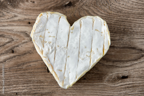 Fototapeta French Neufchatel cheese shaped heart on a wooden table obraz