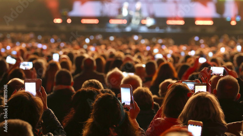 Photo  many people with smart phones at live concert