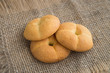 lush ruddy biscuits shot on sack, cookies on natural rustic background