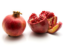 Two Pomegranate Isolated On White Background One Whole And One Open.